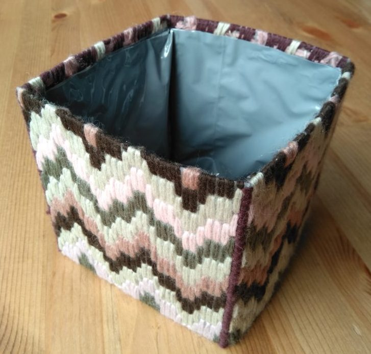 Embroided plant pot with plastic lining