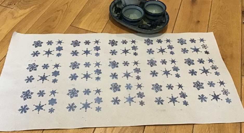 Gift wrapping paper with stencil snowflakes
