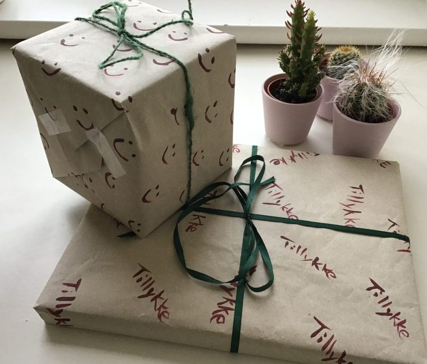 Gifts wrapped in recycled and hand painted paper