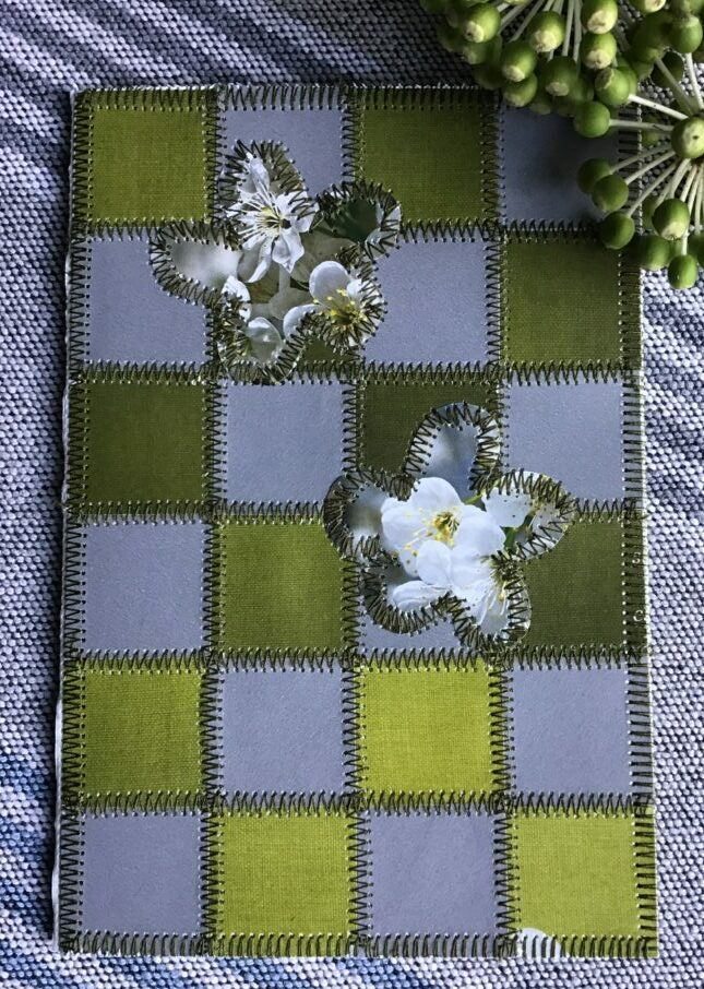 Paper patchwork in grey and green colours and flowers