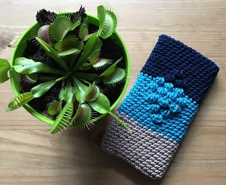 Crochet phone cover with bubble pattern