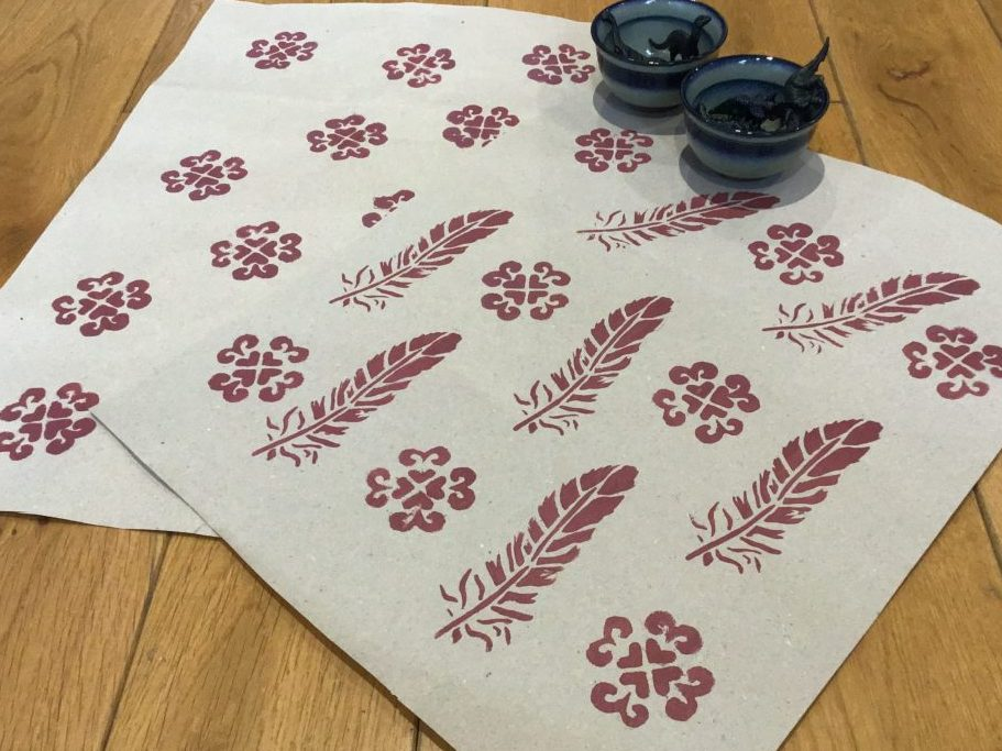 Stencil prints on gift wrapping paper