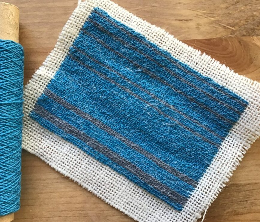Tambour embroidering with thin cotton yarn in blue colours