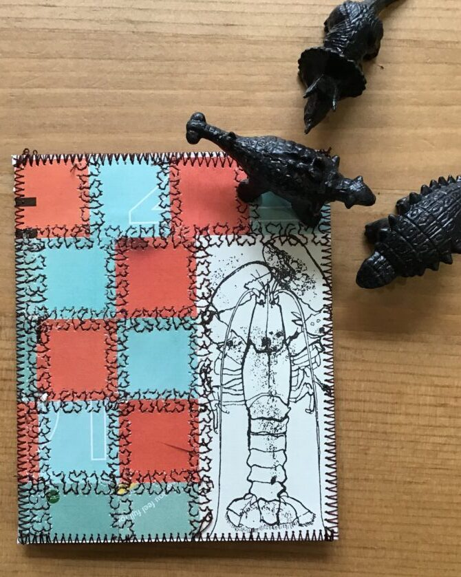 Card made with paper from books and magazines