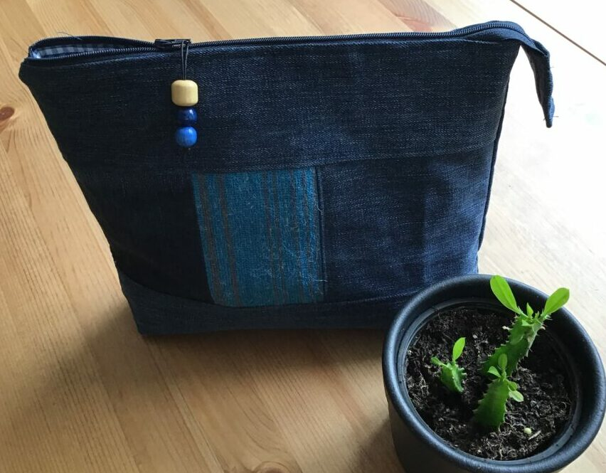 Wash bag made out of old jeans and other recycled materials