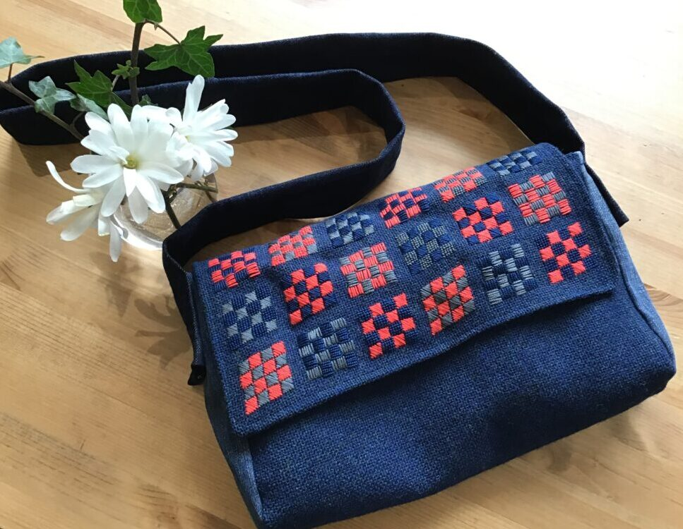Bag with embroidery made out of wool fabric, old jeans and an upcycled shirt.
