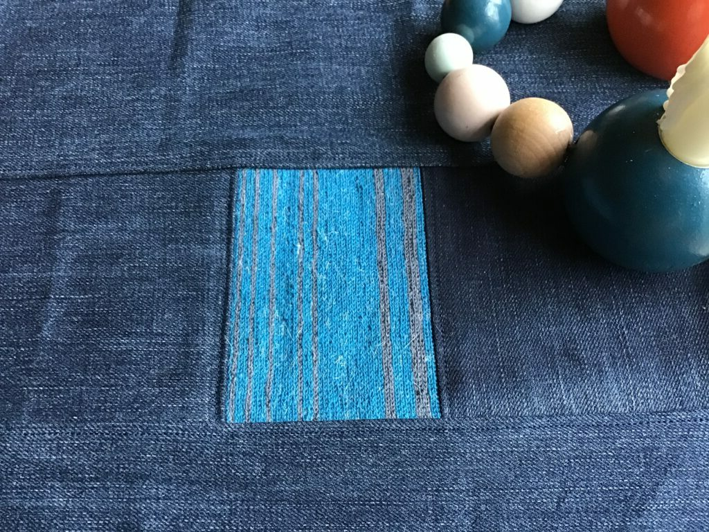 Cotton tambour embroidery sewn into recycled jeans fabric